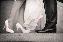 Wedding details. Feet of the groom and the bride Royalty Free Stock Images