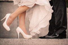 Wedding details. Feet of the groom and the bride Stock Image