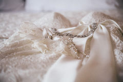 Wedding details. Beautiful accessories. Exquisite ornaments. White dress Royalty Free Stock Photo