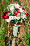 Wedding details. Beautiful wedding bouquet of peonies on a tree Stock Image