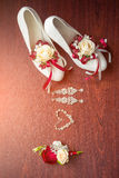 Wedding details. Bouquet and accessories of bride and groom Royalty Free Stock Image