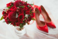 Wedding details. Bouquet and Shoes - Flowers for a wedding Stock Images
