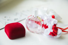 Wedding details. Bridal accessories. perfume, jewelry and rings Stock Photography