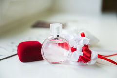 Wedding details. Bridal accessories. perfume, jewelry and rings Royalty Free Stock Photography