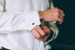 Wedding details, cufflinks, elegant male suit. And hands Stock Photos
