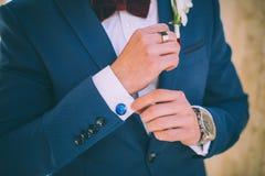 Wedding details, cufflinks, elegant male suit Royalty Free Stock Photography
