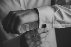 Wedding details, cufflinks, elegant male suit and Stock Images