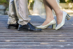 Wedding details, feet of bride and groom, wedding. Shoes Stock Photos