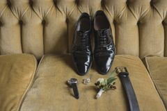 Wedding details. Groom accessories. Shoes, cufflinks, belt, watch, boutonniere Royalty Free Stock Photography