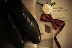 Wedding details groom shoes bow tie and rose Royalty Free Stock Images