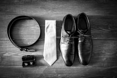Wedding details. Man accessories. Wedding details accessory Groom Shoes, belt Royalty Free Stock Image