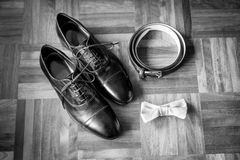 Wedding details. Man accessories. Wedding man details. Groom accessories. Man Shoes, belt, bowtie Royalty Free Stock Image