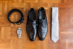 Wedding details. Man accessories. Wedding man details. Groom accessories. Man Shoes, belt, tie, watch Royalty Free Stock Images