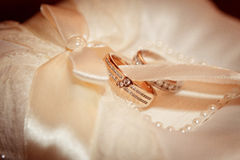 Wedding details. Rings on the stand Stock Photo