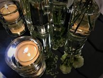 Wedding details: roses and candles royalty free stock image