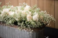 Simplistic and Rustic White Table Arrangement - Wedding/Event Decor. Wedding details that speak to the theme of true love. This is a rustic and simplistic Royalty Free Stock Photos