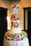 Wedding details - wedding cake dessert with flowers as decor royalty free stock photos