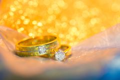 Wedding diamond ring. Couple wedding diamond ring with bokeh gold color, symbol of engagement and wedding royalty free stock photos