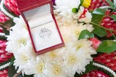 Wedding Diamond Ring on Flowers Royalty Free Stock Image