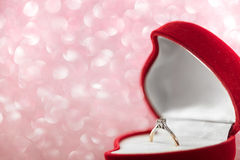 Wedding diamond ring in  red heart shaped gift box Royalty Free Stock Images