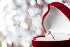 Wedding diamond ring in  red heart shaped gift box Stock Photo