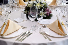 Wedding diner table. Table preparing for after wedding ceremony diner in luxury hotel's restaurant Stock Photos