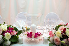 Wedding dinner. Romantic dinner with candles and flowers Stock Images