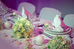 Wedding dinner. Beautiful yellow roses decorating wedding dinner table Royalty Free Stock Images