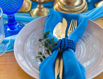 Wedding dinner table detail in white, gold and blue color. Selec Stock Photo