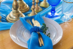 Wedding dinner table detail in white, gold and blue color. Selec Royalty Free Stock Photo