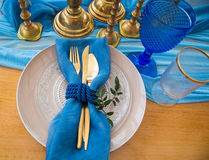 Wedding dinner table detail in white, gold and blue color. Selec Royalty Free Stock Image