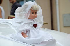 Wedding doll. On a car Royalty Free Stock Photo