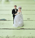 Wedding doll. On light green wooden table Royalty Free Stock Photo