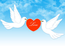 Wedding dove couple. Two loving white pigeons with red heart on blue cloudy sky for wedding invitations , valentine's day cards Royalty Free Stock Images