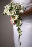 Wedding dres and bouqet Royalty Free Stock Images