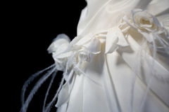 Wedding Dress. Detail of the wedding dress withe Roses and feathers stock images