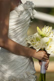 Wedding Dress. With nice white roses as decoration and other flowers hold by the bride stock photos