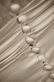 Wedding Dress. Details from the back of a wedding dress. Picture in sepia Stock Image