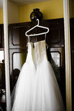Wedding dress. Hung up on case stock images