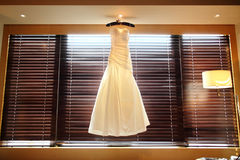 Wedding dress. In front of the window Stock Photography