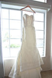 Wedding Dress. Brides wedding dress hanging by a window Royalty Free Stock Photography