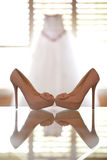 Wedding Dress. Brides wedding dress hanging by a window Stock Photo