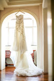 Wedding dress. Hanging on the window Royalty Free Stock Photography