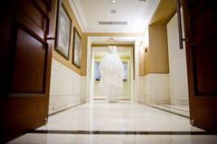 Wedding dress. Beautiful wedding dress hanging in the middle of the corridor Royalty Free Stock Photos