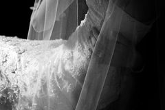 Wedding Dress. Close up. Dress and Grooms Hand royalty free stock images