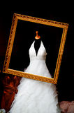 Wedding dress. In the gold picrture frame Stock Image