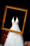 Wedding dress. In the gold picture frame Royalty Free Stock Image