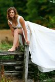 Wedding dress. Female wearing wedding dress, natural setting Stock Images
