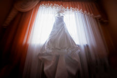 Wedding dress against the window Royalty Free Stock Images