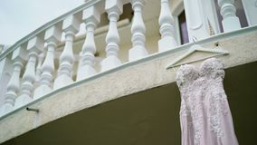 Wedding dress on a balcony stock video